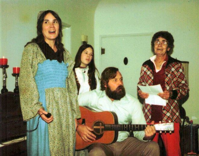 Greatly bearded stepdad on guitar, mum in handmade dress, shy teen Dinah in back, enthusiastic choir-member grandma with sheet music keeping us on track