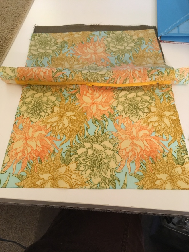 A good view of the big bold flowers of the lining fabric at this step of arranging everything neatly to be pinned and sewn together.