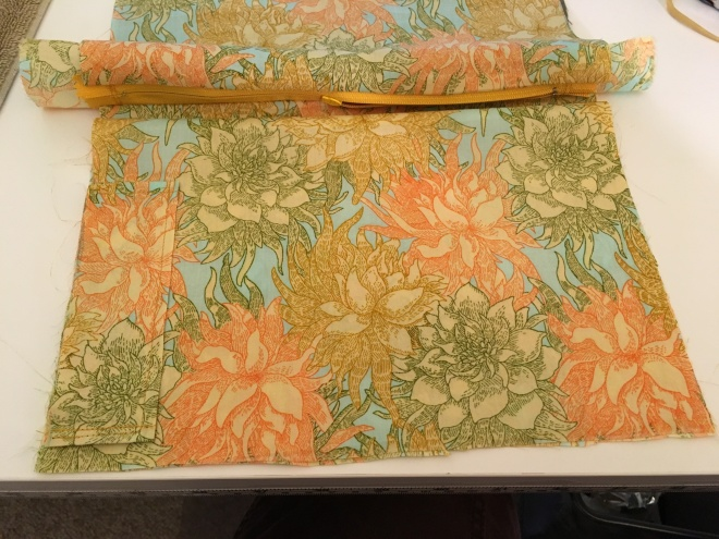 You can see here I was lucky with my cutting (and the fabric design) to be able to beautifully match the flower pattern of the pen pocket so that it flows right into the pattern on the divider layer below it.